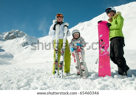 Family winter vacation in ski resort - stock photo