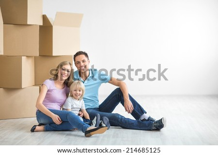 Family with a child at home - stock photo