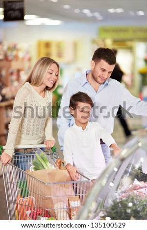 Family with a child in a store - stock photo