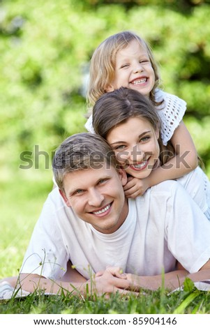 Family with a child outdoors - stock photo