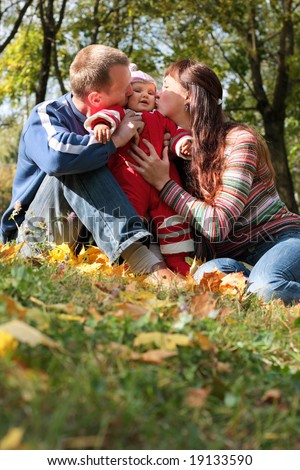 family with autumn leaves - stock photo