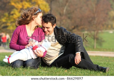 family with baby in autumn park