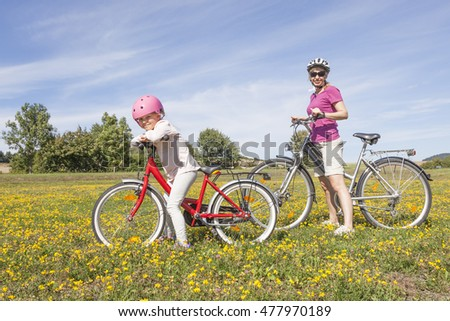 Family with bikes enjoying summer day in a park