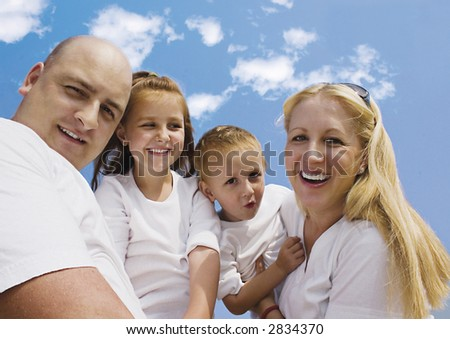 family with blue sky