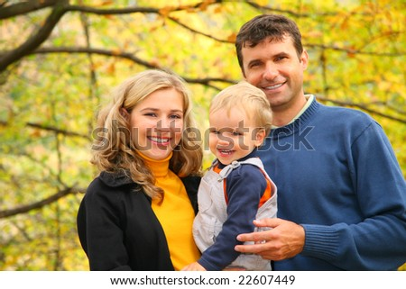 family with boy in autumn park