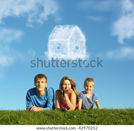 family with boy on grass and dream cloud house collage - stock photo