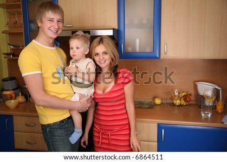 family with boy on kitchen - stock photo