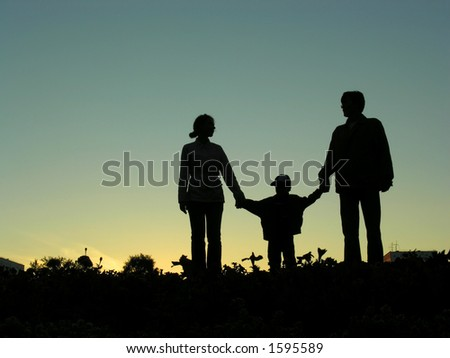 family with boy sundown 2 - stock photo