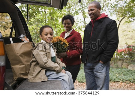 Family with car - stock photo