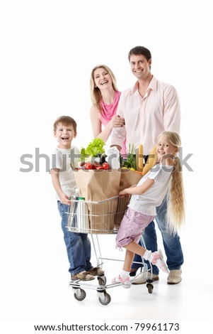 Family with cart with purchases isolated - stock photo