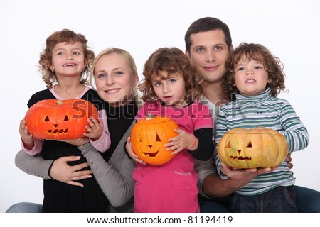 Family with carved pumpkins - stock photo