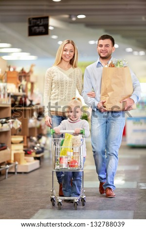 Family with child in a store - stock photo