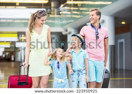 Family with child in the airport - stock photo