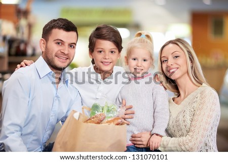 Family with children in shop - stock photo