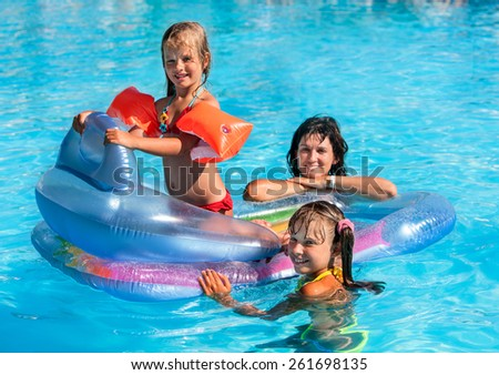 Family with children in swimming pool. Summer outdoor. - stock photo