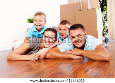 Family with children moving in into a new place.  - stock photo