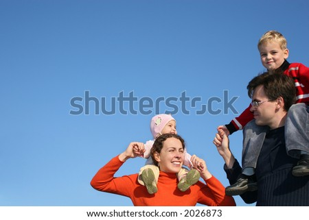 family with children on shoulders - stock photo