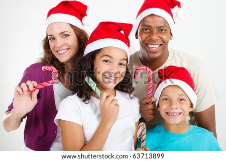 family with Christmas candy cane - stock photo