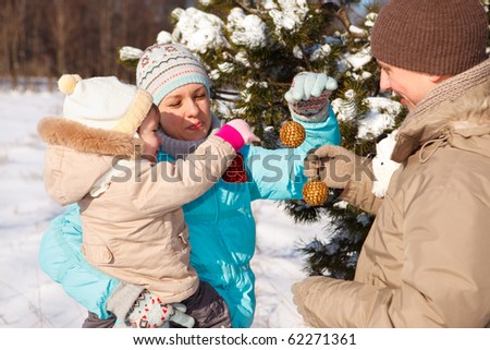 Family with Christmas decoration - stock photo