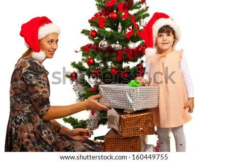 Family with Christmas gifts sitting near tree - stock photo