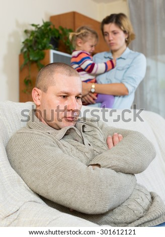 Family with crying little child having conflict at home - stock photo