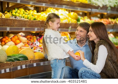 Family with daughter indoors - stock photo