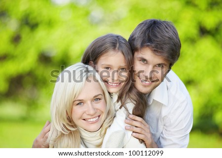 Family with daughter outdoors - stock photo