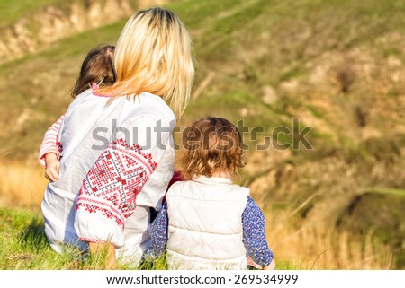 family with daughters outdoors   - stock photo