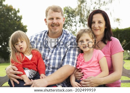Family with Downs Syndrome daughter - stock photo