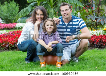 family with flowers in park