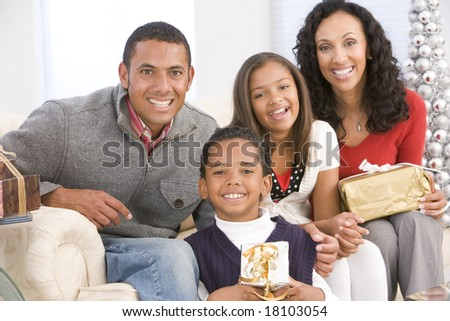 family with gifts at christmas - stock photo