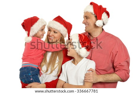 family with kids   in santa hats on background