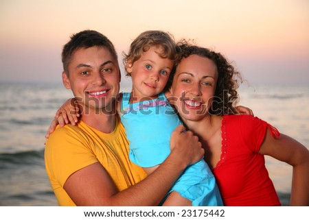 Family with little girl on sea background