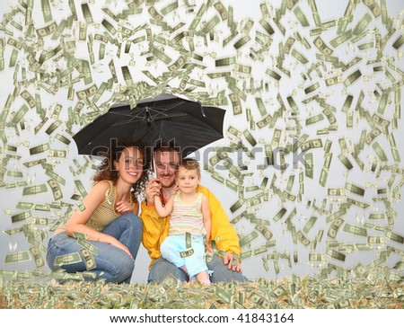 family with little girl with umbrella under dollar rain collage - stock photo