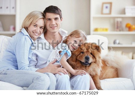 Family with pets at home - stock photo