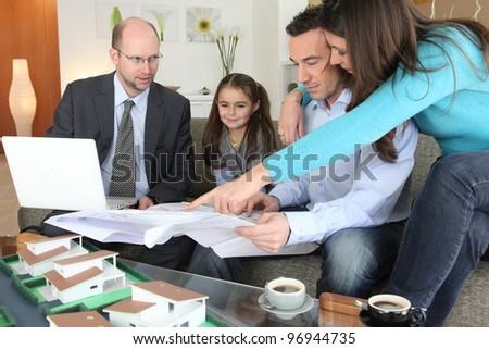 Family with realtor - stock photo