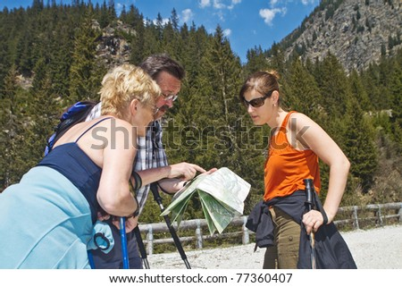 Family with senior parents hiking in the alps in Austria. - stock photo