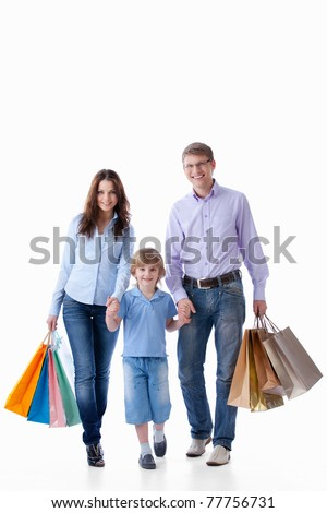 Family with shopping bags on a white background - stock photo