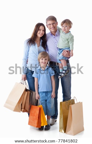 Family with shopping on white background