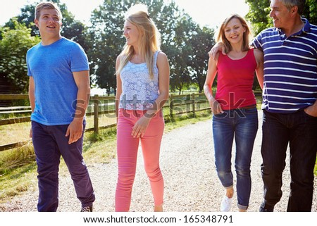 Family With Teenage Children Walking In Countryside - stock photo