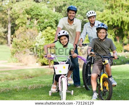 Family with their bikes - stock photo