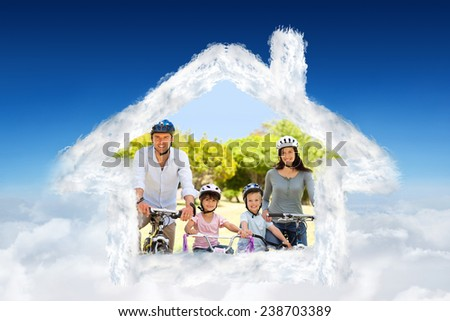 Family with their bikes against blue sky over clouds - stock photo