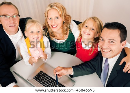 Family with their consultant (assets, money or similar) doing some financial planning - symbolized by a piggy bank in the front - stock photo
