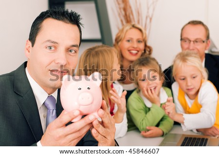 Family with their consultant (assets, money or similar) doing some financial planning - symbolized by a piggy bank in the front, the consultant in front looking at the camera - stock photo