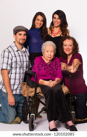 Family with their handicapped grandmother on a white background.