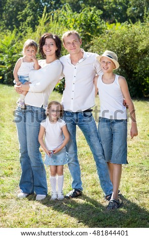 Family with three children on the park