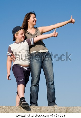 Family with thumb up on a sky background