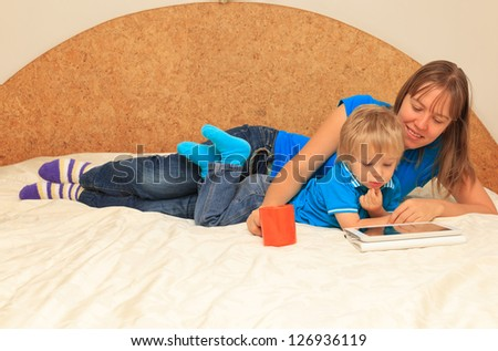Family with touch pad at home - stock photo