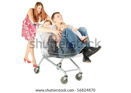 family with two children. father with son and daughter is sitting in shopping basket. woman is smiling. isolated. - stock photo