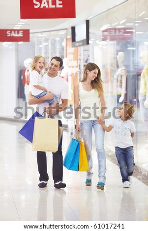Family with two children in the store - stock photo